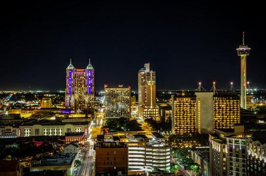 San Antonio city skyline panorama at night. The skyline in this photo includes Marriott Rivercenter, The Torch of Friendship, Marriott Riverwalk