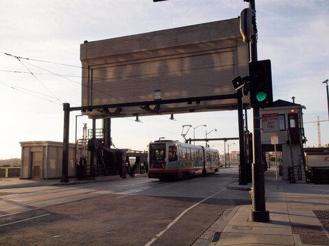 T Muni Light-rail train crosses 4th street bridge