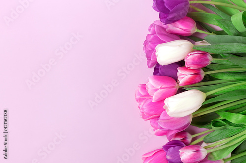 Bouquet of tulips isolated on pink background Top view flat lay Happy mother's day, International women's day, Easter concept Holiday card