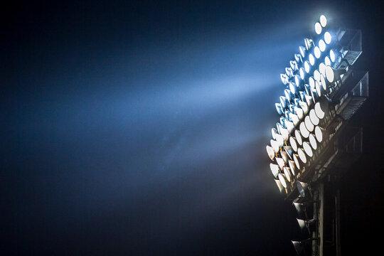 Lights at night. Spotlight illuminates the field at the sports stadium