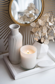 Luxurious white tray decoration, home interior decor with burning candle
