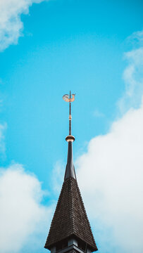 Low Angle View Of Weather Vane Against Sky