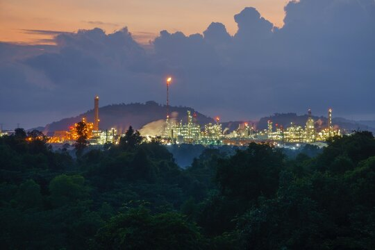 View Of Heavy Industry Factories During Dawn Surroundings By Forest.