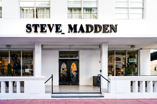 Miami Beach, USA - May 5, 2018: Art Deco district of South Beach in Florida with shoes clothing store sign for Steve Madden on Lincoln road street in summer