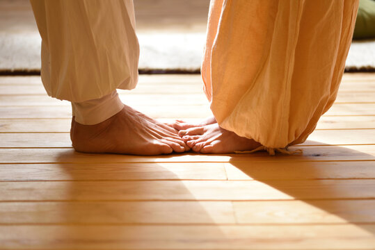 Bare feet of a man and a woman doing yoga as a couple