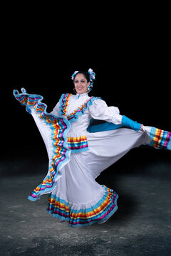 Latin woman dressed in a dress from Jalisco Mexico,