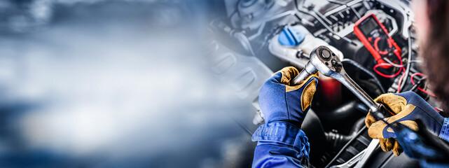 Fototapeta Auto mechanic working on car broken engine in mechanics service or garage. obraz