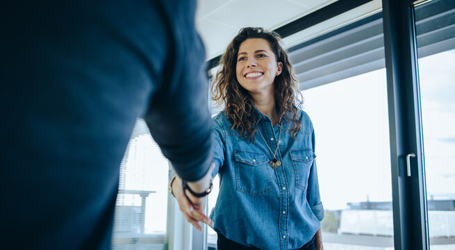 Employer shaking hands with job candidate