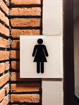 Woman Restroom Sign On Wall Background