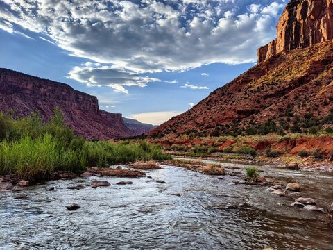 Scenic View Of Mountains Against Sky. Canyons Meet A Beautiful River In The American Southwest.