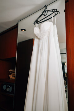 Low Angle View Of Clothes Hanging On White Curtain At Home