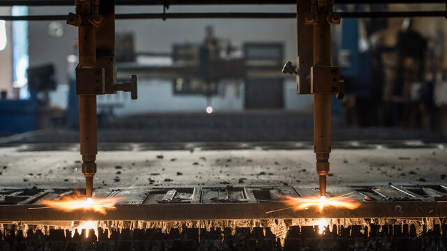 Close-up Of Machine Heating Metal In Factory
