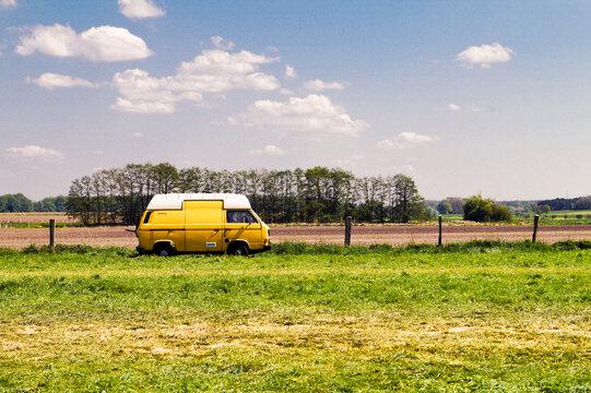 Van Parked By Field Against Sky