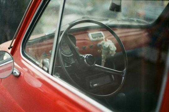 Close-up Of Steering Wheel Seen Through Window