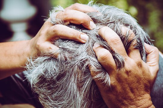 Close Up Of Old Man Feel Headache While Depressed From Work