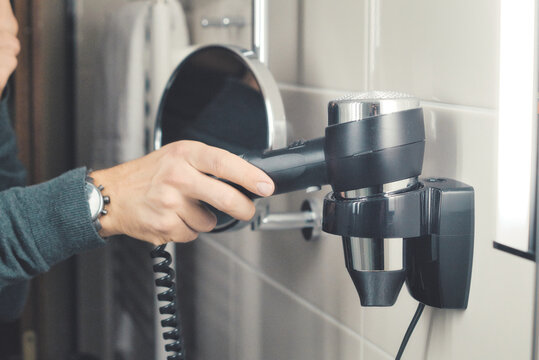 Midsection Of Woman Holding Hair Dryer At Home