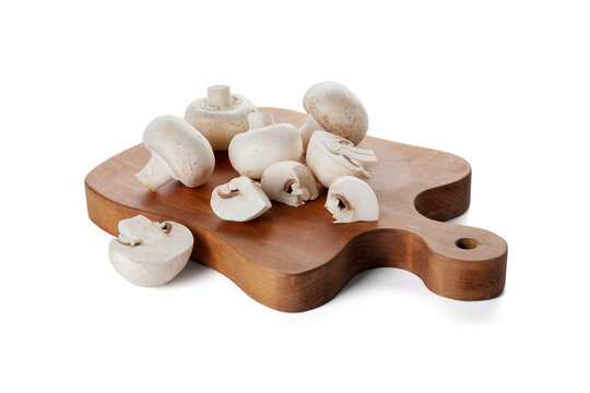 Cutting board with mushrooms on white background