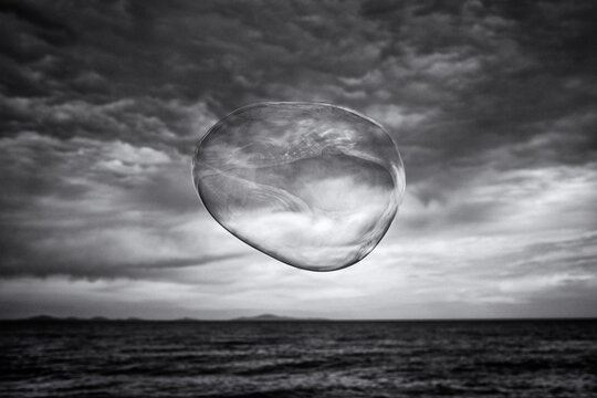 Bubbles In Sea Against Sky