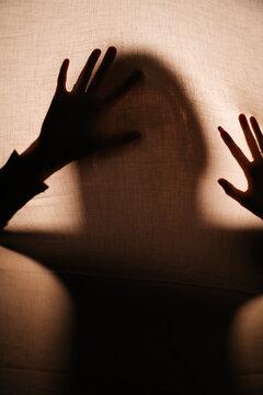 Shadow Of Woman Seen Through Curtain