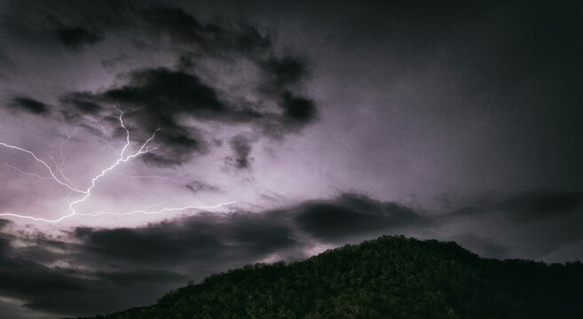 Low Angle View Of Lightning Against Sky At Night