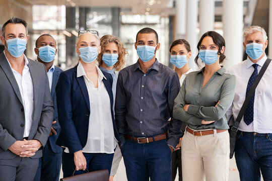 Portrait of multiethnic business people group wearing mask