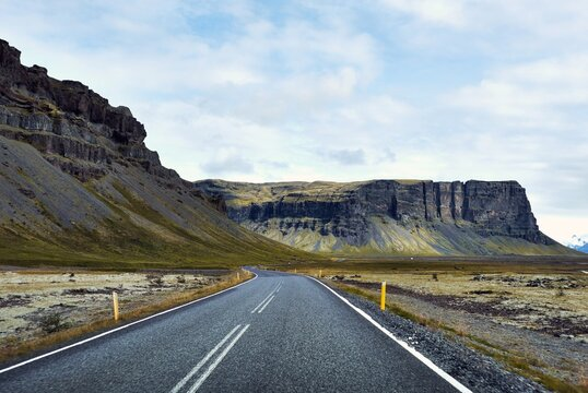 Road Leading Towards Mountains Against Sky - Iceland Golden Circle