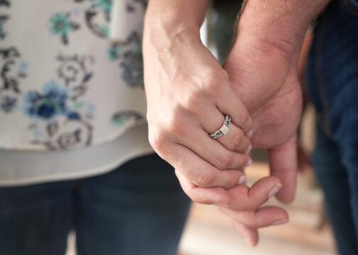 Midsection Of Couple Holding Hand Outdoors