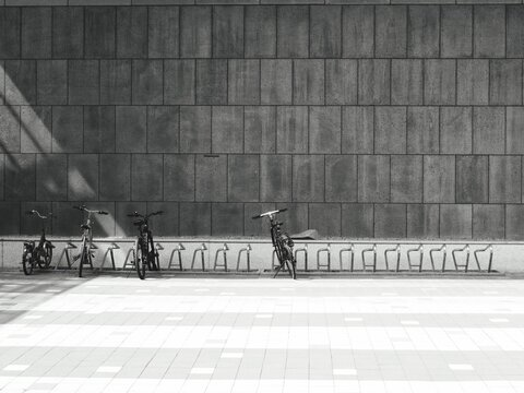 People Riding Bicycle On Wall