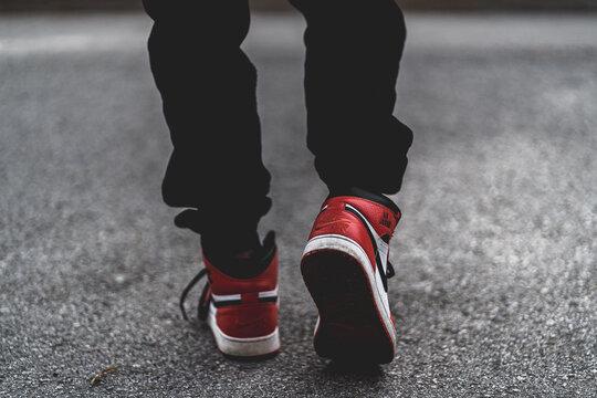 VANCOUVER, CANADA - Jul 10, 2019: Person wearing Jordan 1s sneaker walking away