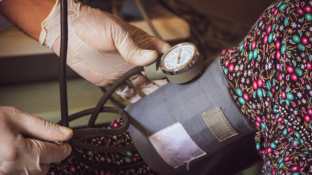 Cropped Image Of Doctor Checking Blood Pressure