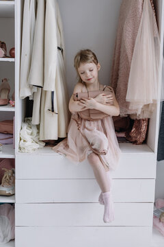 Portrait of A Little Girl in A Beautiful Dress. Girl looks at the camera