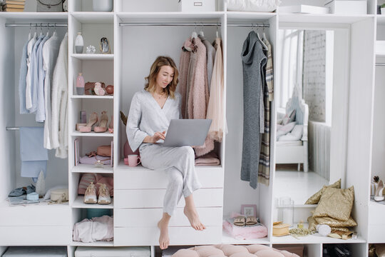 Young woman chooses things online from the comfort of your dressing room. Online shopping