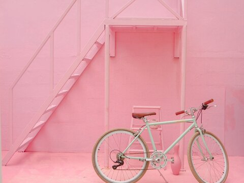 Bicycle Leaning On Wall Of Building