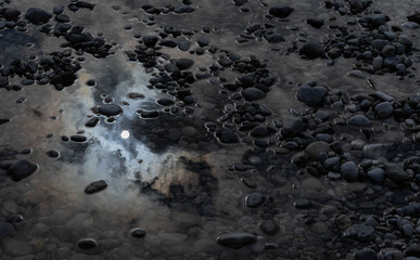 The sun reflected in a puddle