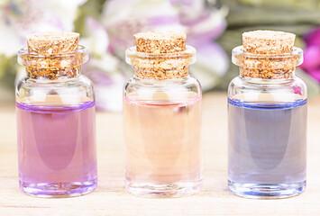 Bottles of colorful floral essential oil. Alternative medical concept.