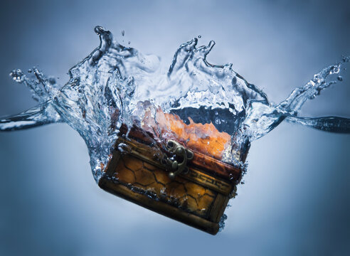 Treasure chest sinking in water