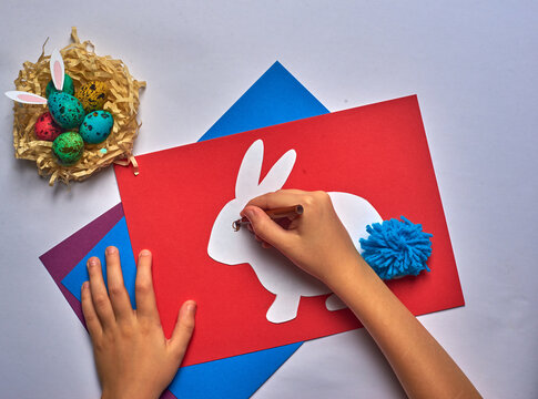red blue purple sheet of paper with easter white hare