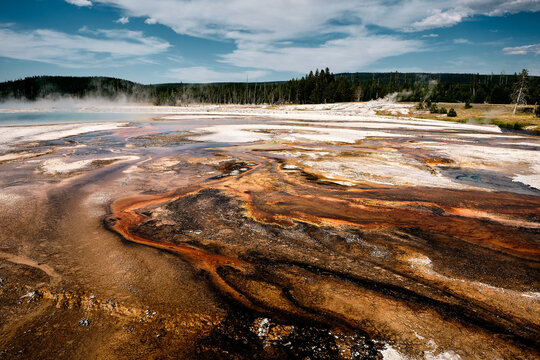 Scenic shot of a black sand basin in Yellowstone National Park, Wyoming USA