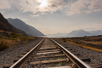 Wall Murals Railroad Railroad Track Leading Towards Mountains Against Sky