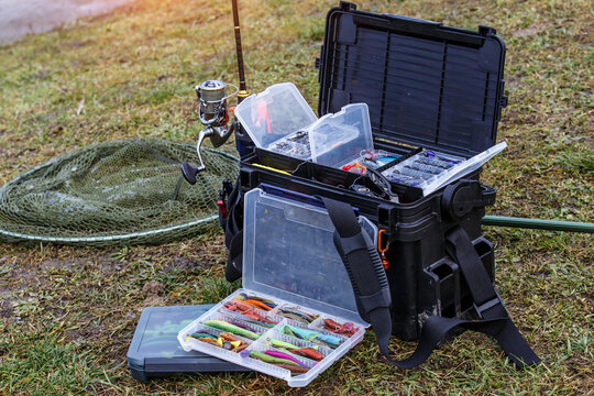 A large fisherman's tackle box fully stocked with lures and gear for fishing.fishing lures and accessories in the box background.
