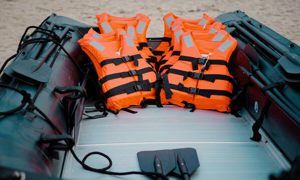 High Angle View Of Life Jackets In Boat At Beach