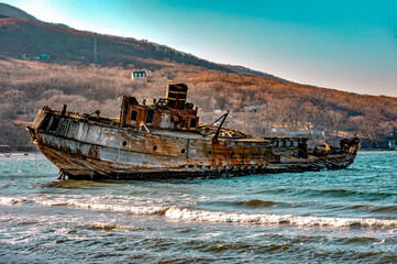 An old animal schooner after a shipwreck in a bay of the sea of ​​Japan / abandoned ship wrecked