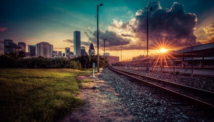 Railroad Tracks And Buildings During Sunset