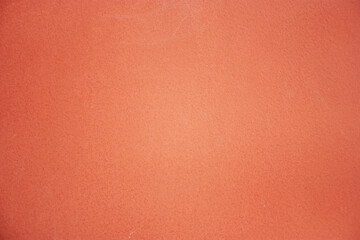 Close-up of painted surface. Bright color of a natural painted wall of the house. Fragment of a...