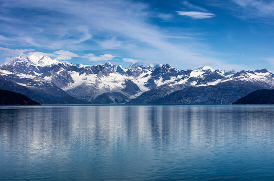 Wide view of Alaska Glacier bay landscape during late summer with ship going very close to the coastline