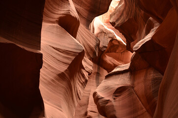 Sun Shining Into a Red Rock Slot Canyon