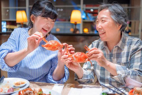 Happy mother and daughter having fun in  restaurant