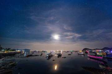 Illuminated City By Sea Against Sky At Night, Harbor Labuan Bajo Indonesia Wall mural