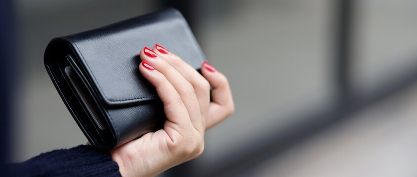 A Woman With A Wallet Ready For Online Shopping