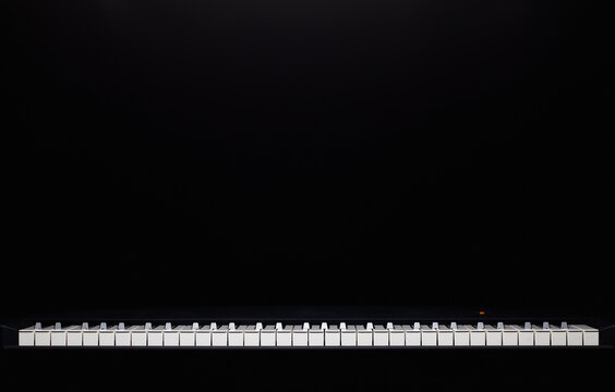 The silhouette of grand piano in the dark room.